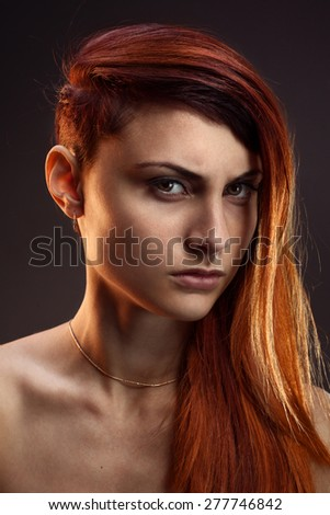 portrait of a beautiful girl with red hair - stock photo