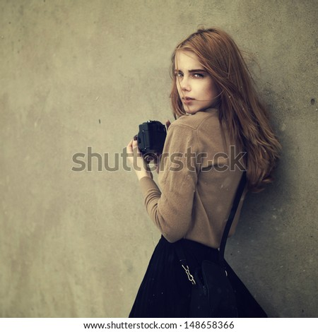 portrait of a beautiful girl with the camera - stock photo