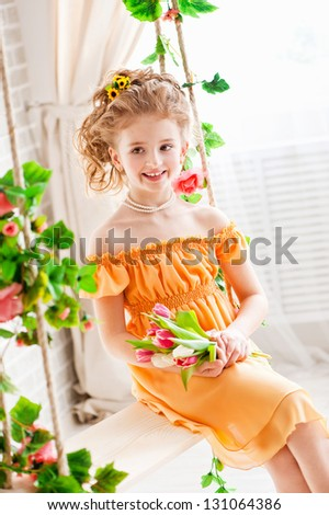 Portrait of a beautiful girl with tulips