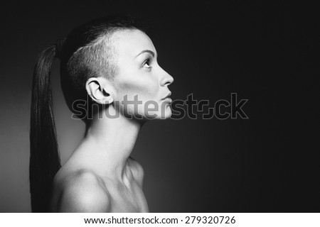 Portrait of a beautiful hairstyle woman on dark background. Developed from RAW; retouched with special care and attention./Beautiful hairstyle woman - stock photo