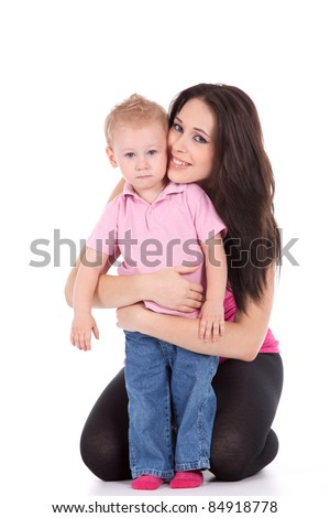 Portrait of a beautiful happy mother with smiling child 2 years boy isolated on white - stock photo