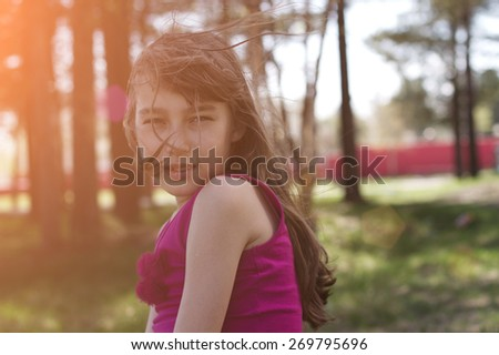 Portrait of a beautiful happy smiling girl outdoors in summer - stock photo