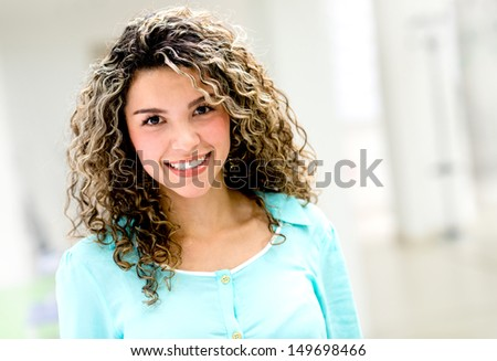 Portrait of a beautiful happy woman smiling indoors  - stock photo