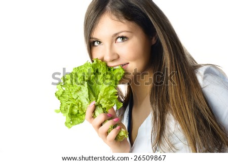 portrait of a beautiful happy young woman eating fresh green salad - stock photo