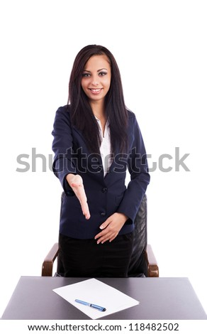 Portrait of a beautiful hispanic businesswoman giving hand for handshake isolated on white background - stock photo