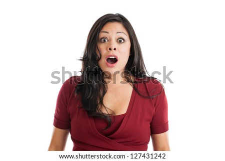Portrait of a beautiful Hispanic woman with shocked expression isolated on white background