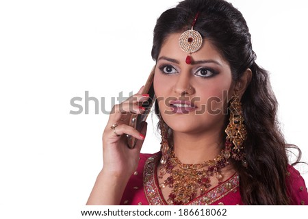 portrait of a beautiful Indian bride using cell phone