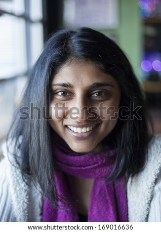 Portrait of a beautiful Indian woman with brown eyes and black hair. - stock photo