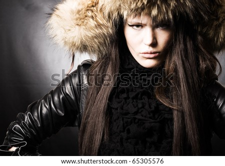 portrait of a beautiful lady in fur cap - stock photo