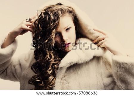 portrait of a beautiful lady in fur coat - stock photo
