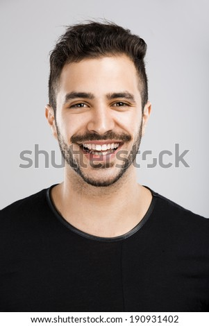 Portrait of a beautiful latin man smiling - stock photo
