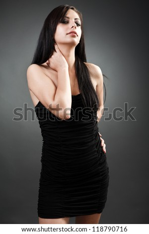 Portrait of a beautiful latin woman standing with hand on hip - stock photo