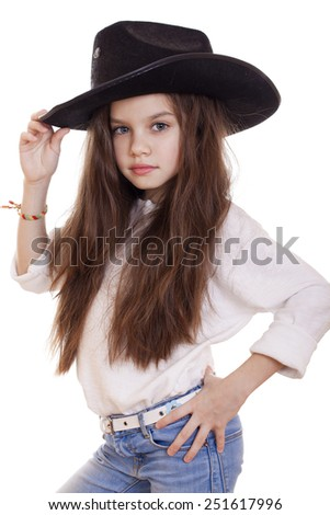 Portrait of a beautiful little girl in a black cowboy hat, studio on white isolated background  - stock photo
