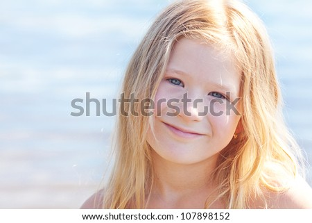 portrait of a beautiful little girl outdoor - stock photo