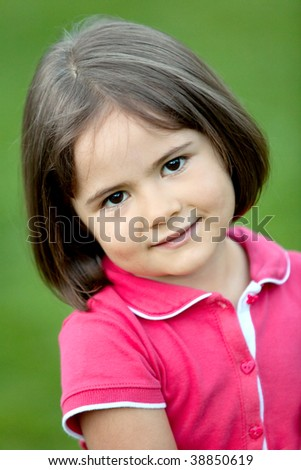 Portrait of a beautiful little girl smiling outdoors