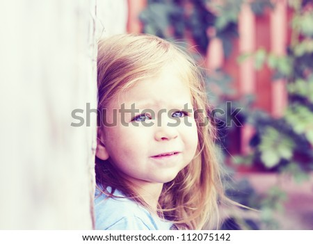 portrait of a beautiful little girl with blue eyes