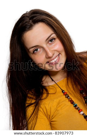 Portrait of a beautiful long-haired brunette girl in orange dress on a white background - stock photo