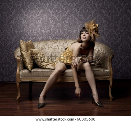 Portrait of a beautiful luxurious glamorous models in gold - stock photo