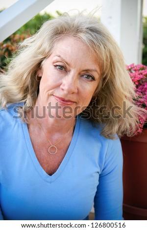 Portrait of a beautiful mature blond woman outdoors. - stock photo