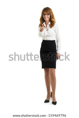 Portrait of a beautiful mature businesswoman showing thumbs up and smiling at the camera against white background. Full length.