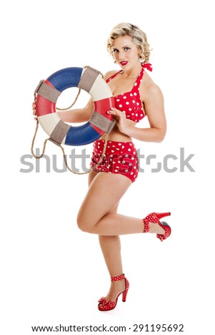 Portrait of a beautiful mid 30s woman dressed in vintage retro polka dot bikini holding life preserver isolated on white - stock photo