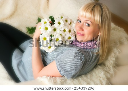 Portrait of a beautiful middle aged pregnant female - stock photo