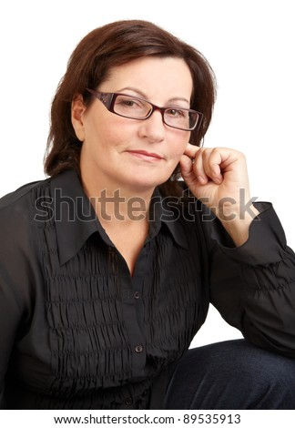 Portrait of a beautiful middle aged woman against isolated on white. - stock photo