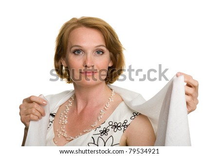 Portrait of a beautiful middle aged woman in a white headscarf. - stock photo