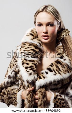 Portrait of a beautiful model in fur - stock photo