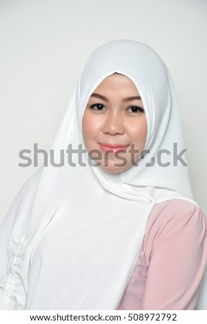 portrait of a beautiful muslim woman wearing a headscarf on white background