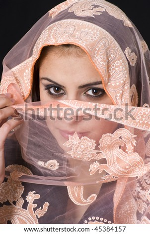 Portrait of a beautiful Muslim woman with brown eyes - stock photo