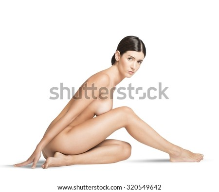 Portrait of a beautiful naked girl sitting - stock photo
