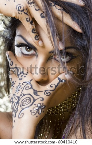 portrait of a beautiful oriental dancer with a tipical egyptian make up