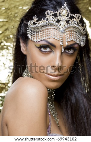 portrait of a beautiful oriental dancer with a typical egyptian make up