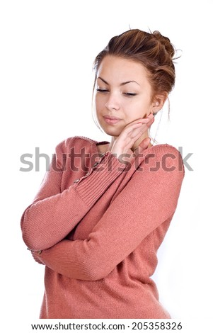 Portrait of a beautiful pensive woman isolated on white background. - stock photo