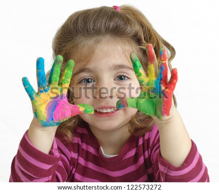 Portrait of a beautiful preschool girl with painted hands in background white - stock photo