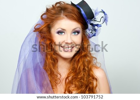portrait of a beautiful red-haired girl in a purple hat handmade. Bride