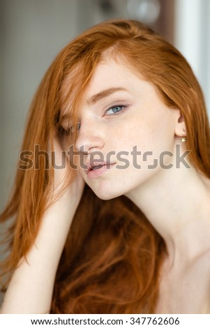 Portrait of a beautiful redhead woman looking at camera