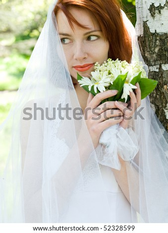 portrait of a beautiful redheaded bride with bouquet