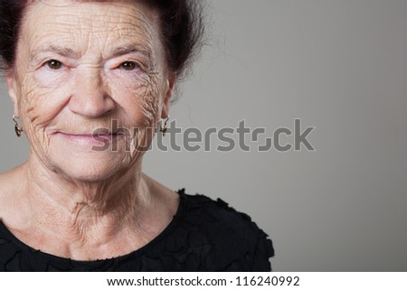 Portrait of a beautiful retired happy senior woman. - stock photo