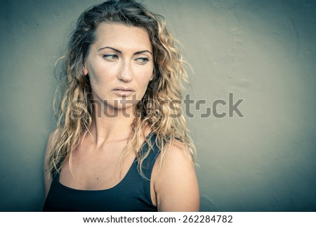 portrait of a beautiful sad blonde girl  at the day time - stock photo