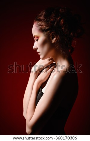 Portrait of a beautiful sad redhead girl. Profile view  - stock photo