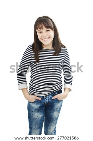 Portrait of a beautiful school girl smiling and posing. Isolated on a white background - stock photo