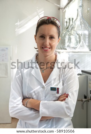 portrait of a beautiful scientist woman - stock photo