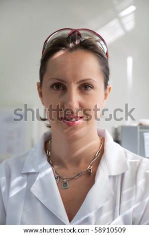 portrait of a beautiful scientist woman - stock photo