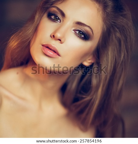 Portrait of a beautiful sensual sexy girl with long blond hair in Studio, close-up - stock photo
