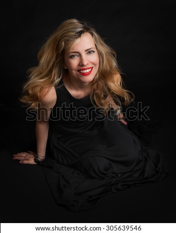 portrait of a beautiful sensuality woman in black dress posing - stock photo