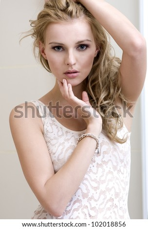 Portrait of a beautiful sensuality young woman with long blonde hair