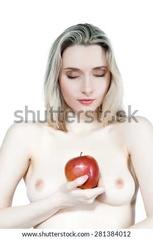 Portrait of a beautiful sexy blonde girl with red apple on a white background, topless, isolate - stock photo