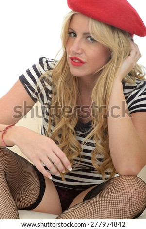 Portrait Of A Beautiful Sexy Young French Woman Wearing A Red Beret Striped Shirt and Fishnet Stockings - stock photo
